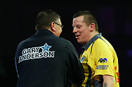 WINNER Gary Anderson shakes Dave Chisnall's hand after a convincing 5-2 set victory during the World Darts Championships 2018 at Alexandra Palace, London, United Kingdom on 29 December 2018.