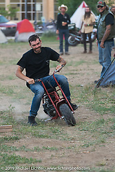 Racing a minibike in the downtown campground set up for the Run to Raton. Raton, NM. USA. Saturday July 21, 2018. Photography ©2018 Michael Lichter.