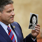 """Michael Garza holds a photograph of Irene Garza while talking to the jury during Feit's trial. Garza said he kept a similar photograph of Irene in his shirt pocket for the duration of the trial against Feit. Garza attempted to portray Feit as """"a wolf in priest's clothing,"""" who preyed upon multiple women in the Valley until his path crossed Irene's. Nathan Lambrecht/The Monitor"""
