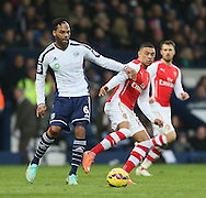 West Brom's Joleon Lescott tussles with Arsenal's Alex Oxlade-Chamberlain<br /> <br /> Barclays Premier League- West Bromwich Albion vs Arsenal - The Hawthorns - England - 29th November 2014 - Picture David Klein/Sportimage