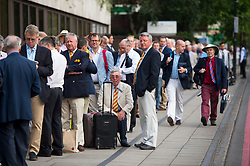 © Licensed to London News Pictures. 16/07/2015. London, UK. Members of the MCC queue outside Lords Cricket Ground ahead of day one of the second Ashes test between England and Australia on July 16, 2015. England are currently one up in the series. Photo credit: Ben Cawthra/LNP