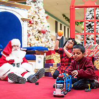 Ramone Montelongo, 8, and his sister Samone, 10, center, have some time to visit with Santa Claus, Sunday Dec. 9 at Rio West Mall before the mall opens to the public. Rio West Mall partnered with Autism Speaks to host it's first Santa Cares event in Gallup, an event for kids with special needs.