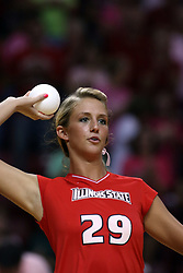 11 October 2008: Mallory Leggett looks for a suitable fan to throw her promotional volleyball to prior a match between the Bulldogs of Drake University and the Redbirds of Illinois State University.  The Redbirds took the match against the Bulldogs 3 sets to none on Doug Collins Court inside Redbird Arena on the campus of Illinois State University in Normal Illinois.