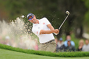 GOLD COAST, AUSTRALIA - DECEMBER 13:  Adam Scott of Australia hits out of the bunker on the 3rd hole during day three of the 2014 Australian PGA Championship at Royal Pines Resort on December 13, 2014 on the Gold Coast, Australia.  (Photo by Matt Roberts/Getty Images)