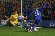 Peterborough United defender Rhys Bennett (16) tackling AFC Wimbledon midfielder Dylan Connolly (16) during the EFL Sky Bet League 1 match between AFC Wimbledon and Peterborough United at the Cherry Red Records Stadium, Kingston, England on 12 March 2019.