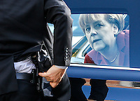 German Chancellor Angela Merkel arrives for a meeting of the European People's Party (EPP) ahead of an European Union summit at Meise, outside Brussels, Belgium, 24 October 2013.