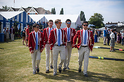 © Licensed to London News Pictures. 04/07/2018. Henley-on-Thames, UK. A group of young men wearing rowing club colours on day one of the Henley Royal Regatta, set on the River Thames by the town of Henley-on-Thames in England. Established in 1839, the five day international rowing event, raced over a course of 2,112 meters (1 mile 550 yards), is considered an important part of the English social season. Photo credit: Ben Cawthra/LNP