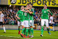 Northern Ireland midfielder Steven Davis scores a goal from the penalty spot and celebrates with his team mates  2-0 during the UEFA European 2020 Qualifier match between Northern Ireland and Estonia at National Football Stadium, Windsor Park, Northern Ireland on 21 March 2019.