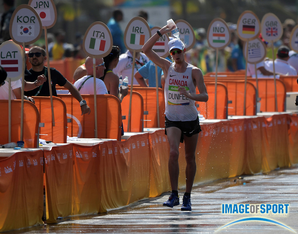 Aug 19, 2016; Rio de Janeiro, Brazil; Evan Dunfee (CAN) douses himself with water in the 50km race walk during the Rio 2016 Summer Olympic Games at Pontal. Dunfee placed fourth in a national record 3:41:38.