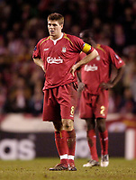 Photo: Jed Wee.<br /> Liverpool v Benfica. UEFA Champions League. 08/03/2006.<br /> <br /> Liverpool's Steven Gerrard echoes the dejection of his team mates and the fans.