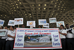May 1, 2019 - Mumbai, Maharashtra, India - Jet Airways employees hold placards and a banner during a protest march demanding to ''save Jet Airways'' on the occasion of May Day at the Chhatrapati Shivaji Maharaj International Airport in Mumbai, India on May 1, 2019. Jet Airways, once India's largest airline, last month suspended all operations after failing to raise enough money to run its services. (Credit Image: © Prash Waydande/NurPhoto via ZUMA Press)