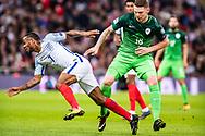 England (7) Raheem Sterling, Slovenia (18)Rajko Rotman during the FIFA World Cup Qualifier match between England and Slovenia at Wembley Stadium, London, England on 5 October 2017. Photo by Sebastian Frej.