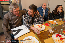 Nicola Martini wth guests to his Mr. Martini Friday night party celebrating the opening of his bar / restaurant at the workshop during the Motor Bike Expo. Verona, Italy. January 22, 2016.  Photography ©2016 Michael Lichter.