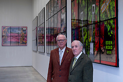 "© Licensed to London News Pictures. 12/04/2021. LONDON, UK.  Gilbert & George pose at their ""NEW NORMAL PICTURES"" exhibition at White Cube's Mason's Yard gallery in Mayfair. The exhibition displays 26 pictures from a new series the pair have been working on for over two years.  The UK government's coronavirus roadmap out of lockdown has allowed art galleries to reopen today. The exhibition runs 13 April to 8 May 2021.  Photo credit: Stephen Chung/LNP"