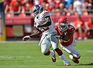 KANSAS CITY, MO - SEPTEMBER 29:  Running back David Wilson #22 of the New York Giants rushes past linebacker Derrick Johnson #56 of the Kansas City Chiefs during the second half on September 29, 2013 at Arrowhead Stadium in Kansas City, Missouri.  Kansas City defeated New York 31-7. (Photo by Peter Aiken/Getty Images) *** Local Caption *** David Wilson;Derrick Johnson