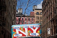 New York. truck covered with graffitis  on Houston street;