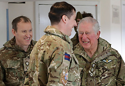 The Prince of Wales (right), Colonel Welsh Guards, laughs as he meets soldiers of the 1st Battalion Welsh Guards after he presented them with their campaign medals at Elizabeth Barracks, Pirbright Camp in Woking, following their return from Afghanistan.