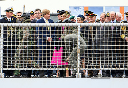© Licensed to London News Pictures. 24/10/2018. London, UK. Armed Marines walk a hostage past King Willem-Alexander,  Queen Maxima, Sophie of Wessex, Prince Edward and the Duke of Kent, on board HNLMS Zeeland during the exercise. British Royal Marines are joined by the The Royal Netherlands Marines in a military demonstration at HNLMS Zeeland, which is anchored next to anchored next to HMS Belfast on the River Thames in central London. Members of the British and Dutch Royal families watched the event as part of a state visit to the UK. Photo credit: Ben Cawthra/LNP