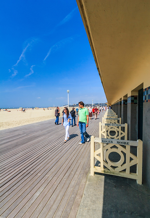 Promenade des Planches in Deauville, France. Beach closets that are dedicated to famous actors and movie makers remind about the Deauville American Film Festival.