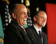 Former New York Mayor Rudolf Giuliani, left,  and Senate candidate for Washington Mike McGavick laugh during a speech at a fund-raising event in Seattle.(AP Photo/John Froschauer).