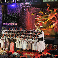Aretha Franklin performs with a choir during the Rockefeller Center Christmas tree lighting ceremony in New York City.