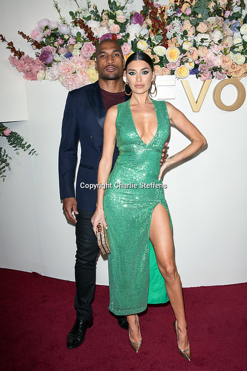 LARRY ENGLISH (L) and NICOLE WILLIAMS attend the 3rd Annual #REVOLVEawards at Goya Studios in Los Angeles, California