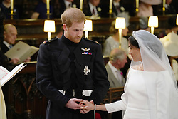 4 in series of 10. File photo dated 19/5/2018 of Prince Harry and Meghan Markle during their wedding service at St George's Chapel in Windsor Castle.