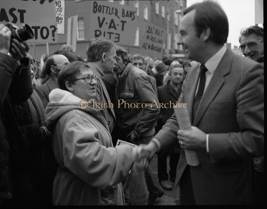 """Irish Theatre Industry Protest at Leinster House.1983.07.12.1983.12.07.1983.7th December 1983...With the imposition of a 23% V.A.T.rate on theatre tickets, the theatre industry was feeling the strain. Maureen potter and Brendan Grace aka """"Bottler"""" led the protest to the gates of Leinster House Dublin..Photo taken as Maureen politely confronts Fianna Fail T.D.Dr Michael Woods over the VAT rate."""