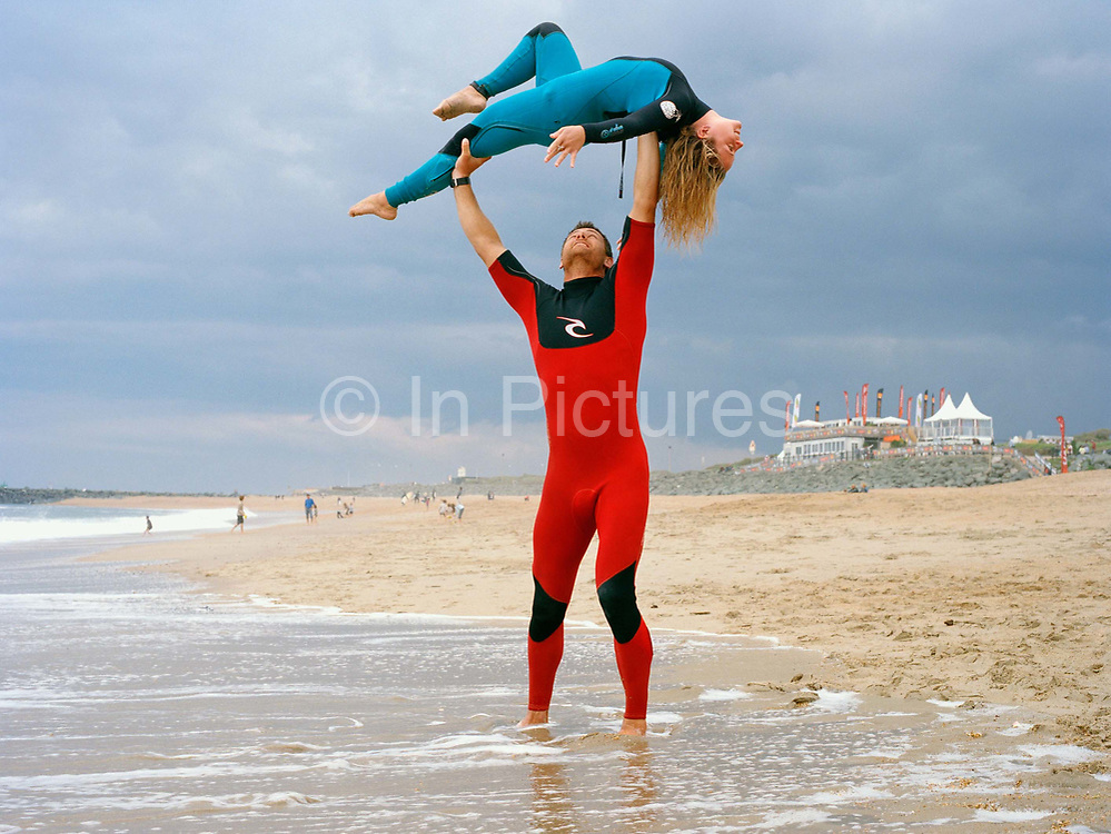 Rico Leroy, 35 and Sarah Burel, 19, demonstrating a tandem Surfing lift the day before the French Tandem Surfing finals. Tandem surfing is a hybrid of surfing and acrobatics. Originating in the 1930s in Hawaii when the Waikiki Beach boys would take female tourists for rides on their boards. The sport was most popular in the 50s and 60 s. It is however currently enjoying a renaissance after several decades in the doldrums thanks mainly to the work of Rico Leroy, a passionate ex-French pole vaulter who has set up the International Tandem Surfing Association  (ITSA).