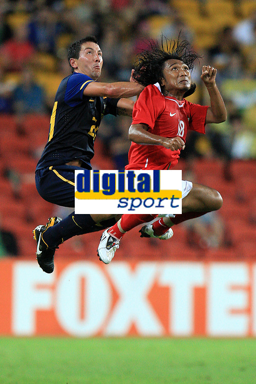 """AUSTRALIA V INDONESIA - 3RD MARCH 2010. Action from the Asian Cup qualifier between the Australian """"Qantas Socceroo's"""" v Indonesia, played at Suncorp Stadium in Brisbane, Queensland, Australia.  PHOTO : SCOTT POWICK / SMP IMAGES / DPPI - JACOB BURNS (AUS) / HARIONO (IND)"""