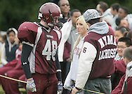 Cornwall-on-Hudson, New York - A New York Military Academy football player talks to two friends during a high school football game against the Harvey School on Oct. 17, 2009.