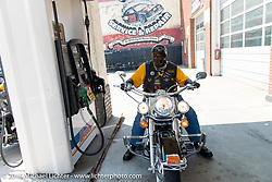 """Archie """"Bad Boy"""" Dennis at a gas stop on the ride back from the """"Horse You Came In On Saloon"""" with the Flying Eagles MC (founded 1950). Baltimore, MD, USA. August 16, 2015.  Photography ©2015 Michael Lichter."""