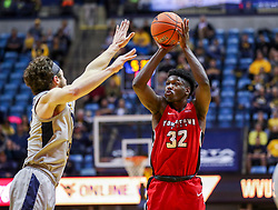 Dec 1, 2018; Morgantown, WV, USA; Youngstown State Penguins guard Garrett Covington (32) shoots a three pointer during the first half against the West Virginia Mountaineers at WVU Coliseum. Mandatory Credit: Ben Queen-USA TODAY Sports