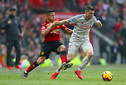 Manchester United's Alexis Sanchez (left) and Liverpool's James Milner battle for the ball