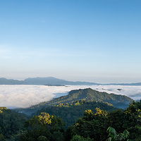 """Panoramic view of the higher elevations of Kaeng Krachan National Park from Panoenthung. The famous """"Sea of fog"""" is visible in the photograph."""