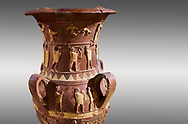 Inandik Hittite relief decorated cult libation vase with four decorative friezes featuring figures coloured in cream, red and black. The processional figures include musicians and acrobats processing to an altar, mid to late 16th century BC - İnandıktepe, Turkey . Against a grey background