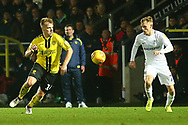 Burton Albion defender Damien McCrory (14) and Coventry City midfielder Luke Thomas (23) during the EFL Sky Bet League 1 match between Burton Albion and Coventry City at the Pirelli Stadium, Burton upon Trent, England on 17 November 2018.