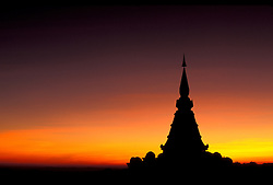 Asia, Thailand, Chiang Mai province, Doi Inthanon Mountain. Sunset silouhette of Buddhist Chedi (temple) Phra Mahathat Naptha Methanidon