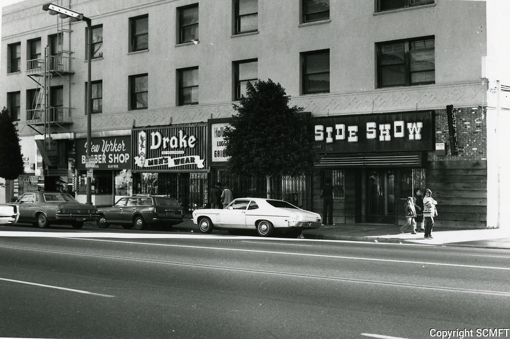 1979 Side Show Bar & Drakes Men's Store on Hollywood Blvd., west of Highland Ave.