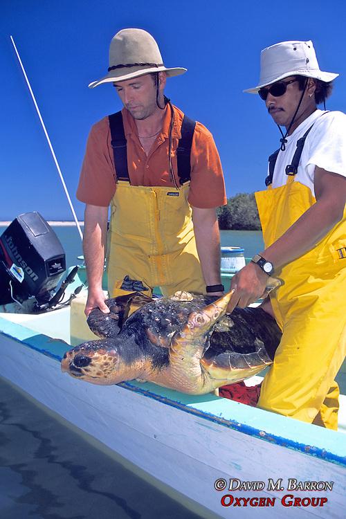 J. & Rodrigo With Loggerhead Sea Turtle