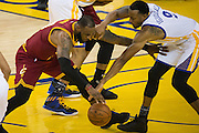 Golden State Warriors forward Andre Iguodala (9) defends Cleveland Cavaliers forward LeBron James (23) at Oracle Arena in Oakland, Calif., on January 16, 2017. (Stan Olszewski/Special to S.F. Examiner)