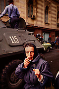 A fearful woman as tanks and armored vehicles roll through Tbilisi, Soviet Georgia