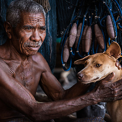 Lamafa, Franciscus Sari, 65 years old (limit 75, then the Lamafa must retire), 17 years whale hunting, 30 whales he killed. Picture of him and the dog. No fear, he lives a happy life, best luck ever are his family, his children.