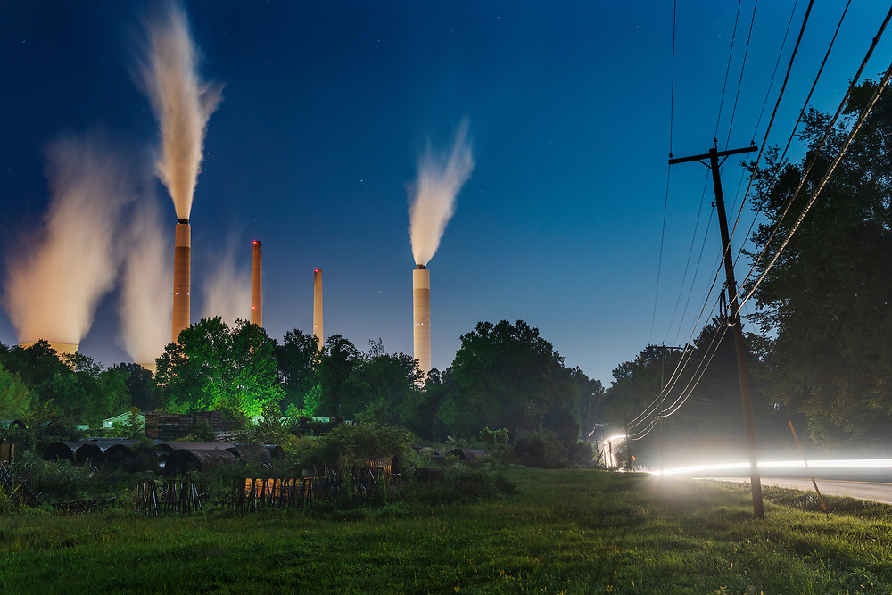 The John E. Amos power plant is seen from a field outside of Winfield, W,Va., on Thursday night, August 23, 2018. Built in the 1970's, the plant is the largest in the American Electric Power system. Many of AEP's smaller coal-fired power plants in Appalachia closed in response to environmental regulations such as the Clean Power Plan in 2015.