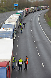 © Licensed to London News Pictures 22/12/2020.        Ashford, UK. Hundreds of freight lorries remain stranded on the M20 in Kent today as France keep their borders closed due to fears over the new Cornavirus strain. Photo credit:Grant Falvey/LNP