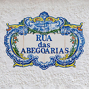Decorated, painted ceramic street sign Rua Dos Abegoarias from Nazare, Portugal