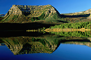Early morning reflection in Trappers Lake, Flat Tops Wilderness, White River National Forest, Colorado. The Flat Tops is the second largest wilderness area in the United States.
