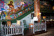 """Iraqi born artist and restauranteur Andy Shallal opened Eatonville in March of 2009,  a """"Southern-themed tribute to the Florida town where author and folklorist Zora Neale Hurston was raised.""""  The restaurant is located across the street from Busboys and Poets, another Shallal venture."""