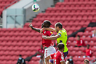 Bristol City's Famara Diédhiou (9) contests a high balll with Exeter City's Ryan Bowman (12) during the EFL Cup match between Bristol City and Exeter City at Ashton Gate, Bristol, England on 5 September 2020.