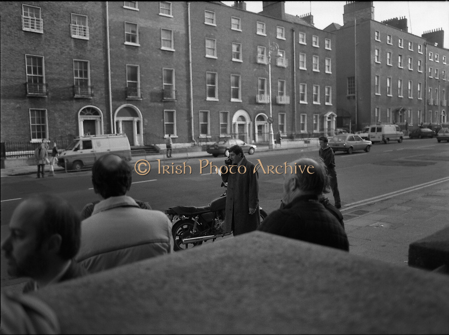 Taoiseach Meets With Guildford Four.   T9..1989..03.11.1989..11.03.1989..3rd November 1989..An Taoiseach, Charles Haughey TD,met  with Paul Hill and Gerard Conlon,two of the Guildford Four. The Guildford Four had been wrongly convicted of a pub bombing and were subsequently released on appeal after 14 years. They had not been compensated for their time in prison and were meeting with the Taoiseach to highlight the injustices they had suffered...Charlie Bird,on phone, RTE news reporter, is pictured awaiting the arrival of Paul Hill and Gerry Conlon at Government Buildings,Dublin.
